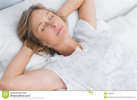 woman sleeping in bed woman sleeping peacefully in bed stock image image 33052081