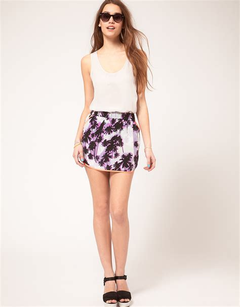 asos asos mini skirt with dolphin hem simple whistles the snap edit