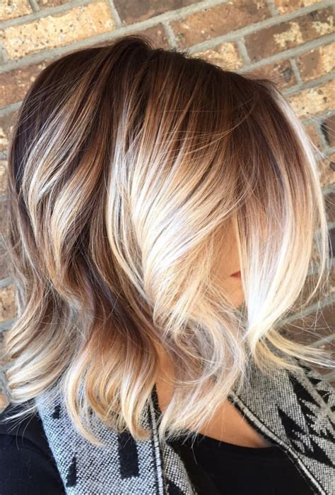 short brown hair with chunky blond brown to blonde balayage with chunky blonde pieces framing