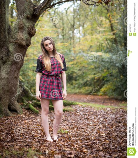 portrait of a beautiful standing in a forest