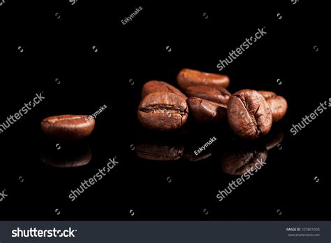 Black Coffee Aromatic luxurious aromatic coffee beans on black background