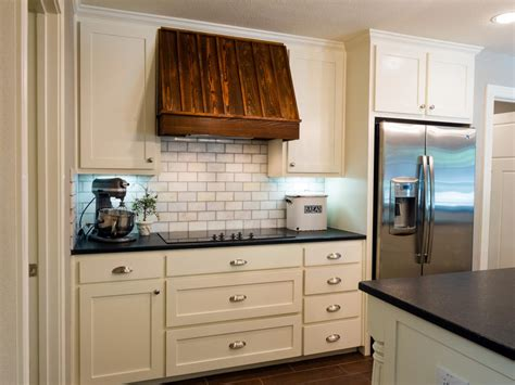 white symmetrical kitchen range with natural wooden fixer upper joanna gaines best outfits hgtv s