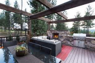 Country House Plans Wrap Around Porch rustic deck with outdoor kitchen by copper creek