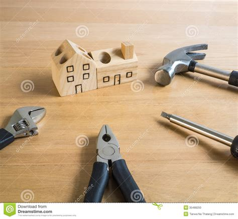 Handcrafted Tools - set of tools and handmade wood house stock photo