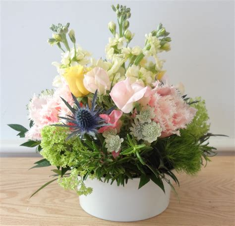 small pastel flower arrangement white vase helen stock