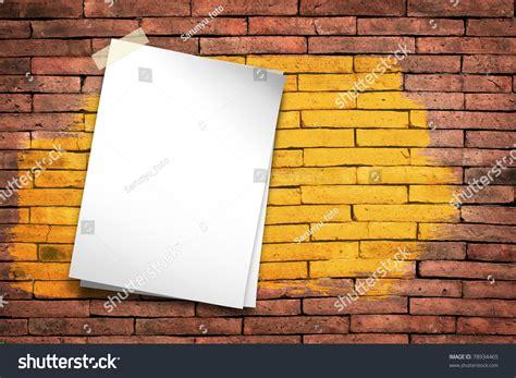stick on wall white paper stick tape brush yellow on the orange brick