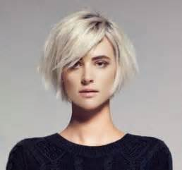 jaw lenght hairstyles that hug the nice chin length bob with those long side swept bangs that