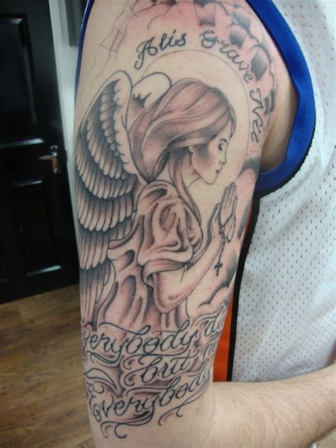 praying woman angel shoulder tattoo