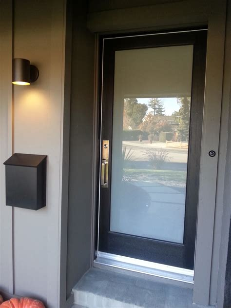 Glass Panel Doors Exterior New Laminated Glass Panel Front Door With Lovely Hardware New Lighting Mailbox And Board And