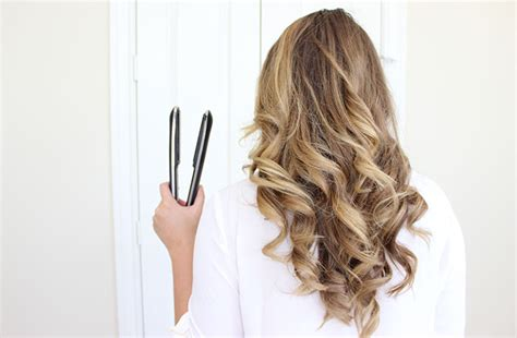 curly hairstyles using straightener how to curl your hair with a flat iron the easy way