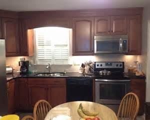 shenandoah cabinetry winchester maple cognac finsh - cognac raised arch parawood pius kitchen bath