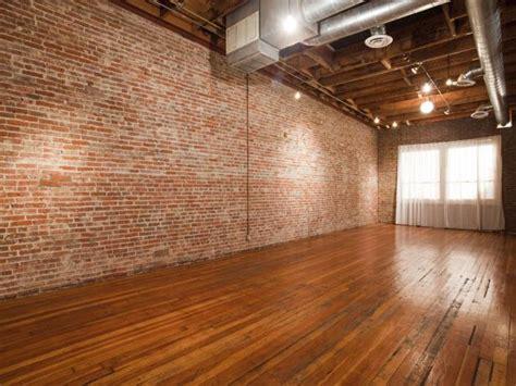 empty urban industrial loft living room hgtv