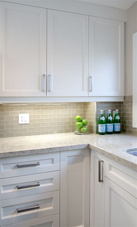 white shaker cabinets gray subway backsplash kashmir