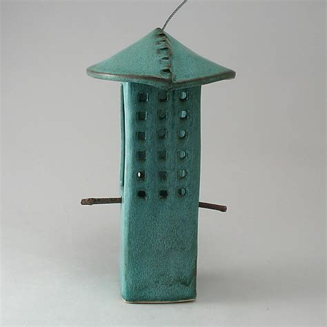 Clay Bird Feeder weathered bronze porcelain bird feeder by cheryl wolff