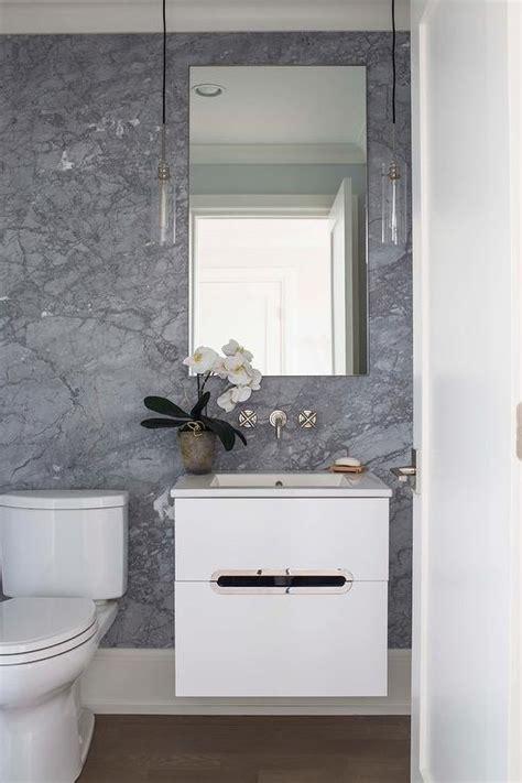 black sink vanity with art deco mirror contemporary