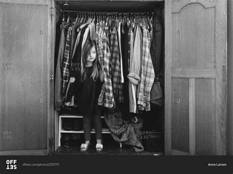 Hiding In The Closet by Hiding In A Closet Stock Photo Offset