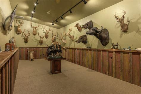 safari room fishing trophy room rustic family room sacramento by