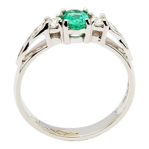 oval emerald and knot engagement ring