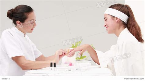 Getting A Manicure by Getting A Manicure At Nail Salon Lizenzfreie