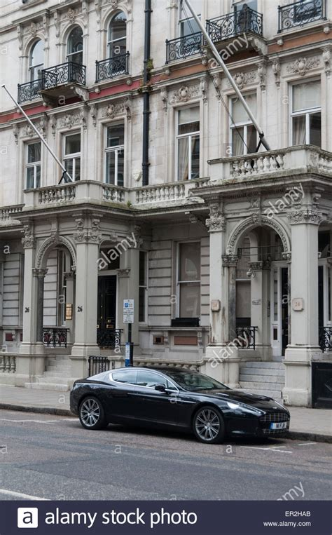 houses to buy in central london aston martin parked in front of expensive houses in central london stock photo