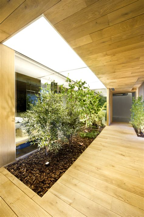 Garden Home Interiors by Industrial Home With Interior Planting And Transparent Walls