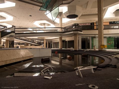 haunting photos of a deserted mall that is now covered in the very loud silence of an abandoned mall architectural