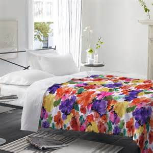 bright floral bedding in a white room bedding