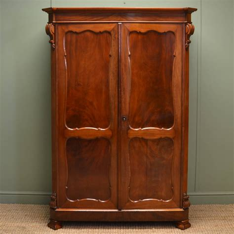 Antique Wardrobes - quality figured mahogany antique cupboard