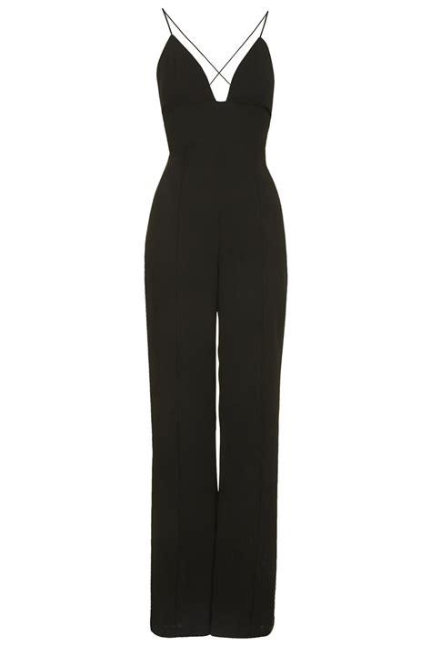 karrueche tran shows cleavage in plunge front bodysuit at 2014 grammys karrueche tran braless in black jumpsuit at brotherly love