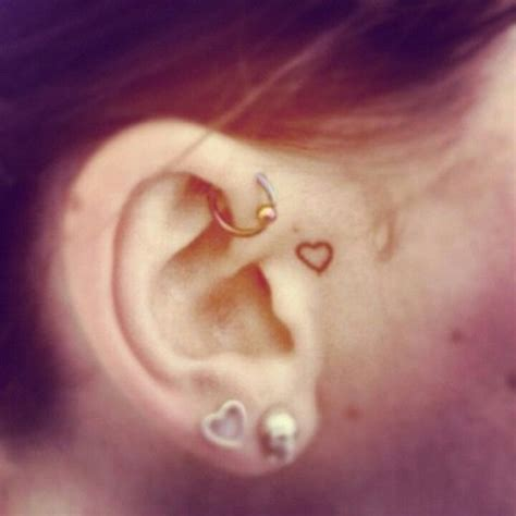 small heart tattoos behind ear small maybe the ear and not in front
