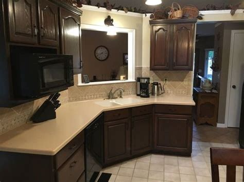 can i stain my kitchen cabinets should i paint or stain my kitchen cabinets hometalk