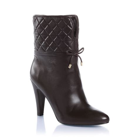 guess quilted ankle boots in brown lyst
