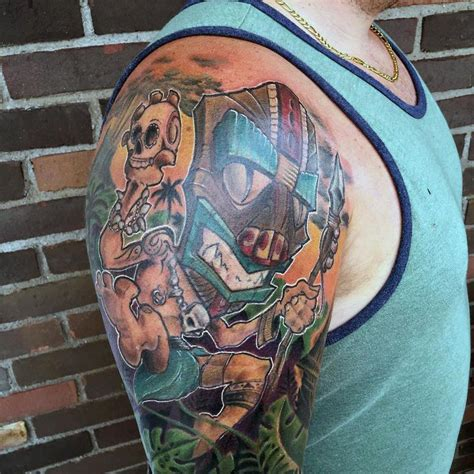new school tattoo michigan tiki god by mikey har tattoos