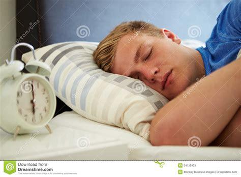 and boys in bed boy sleeping through alarm stock photos image 34155903
