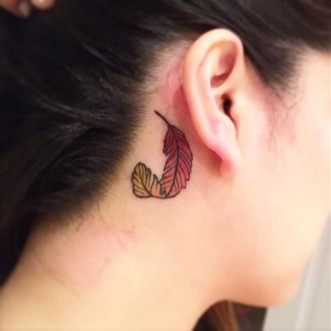 phoenix tattoo behind ear 32 small feather tattoo that will make you want to get inked