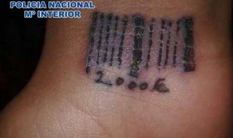 spain prostitutes tattooed  barcodes  sadistic