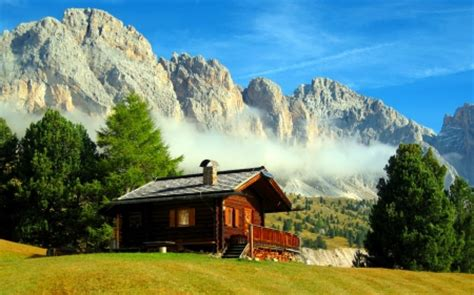 cottages in the mountains mountain cottage mountains nature background