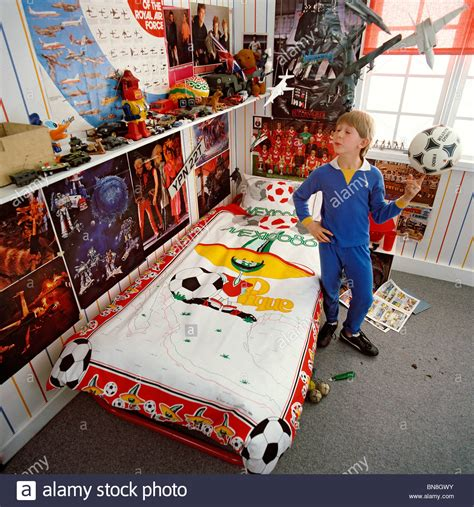 10 year old boys bedroom 9 or 10 year old boy in his bedroom which is full of kids stuff stock photo royalty