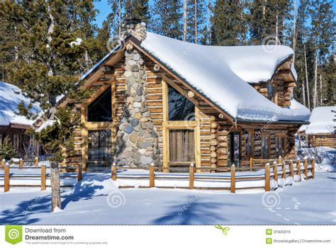 A Frame Lake House Plans log cabin in the winter forest of idaho stock image