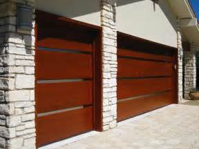 large wood panels and small glass segments between these garage door design