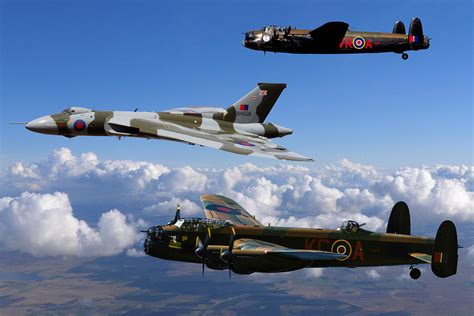 Boomber Voolcon lancaster bombers and vulcan xh558 photograph by ken brannen