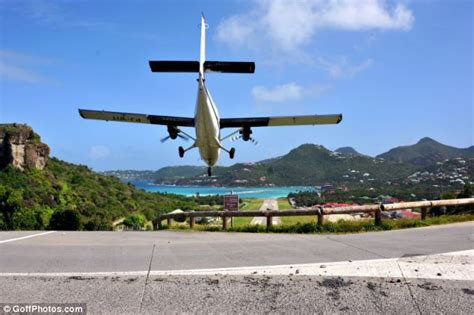 low flying plane narrowly misses motorcyclists at st bart