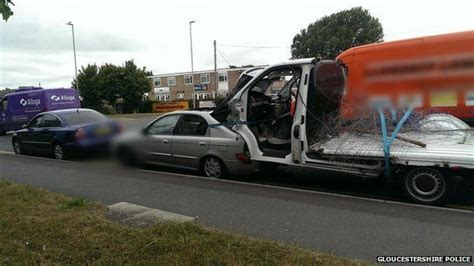 tow cer and boat gloucester driver caught towing van strapped in car boot