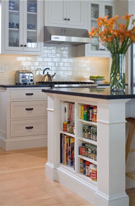 small shelves built into kitchen island for books and