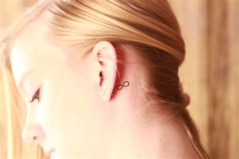 infinity tattoo behind ear meaning feather tattoos behind ear meaning www imgkid com the