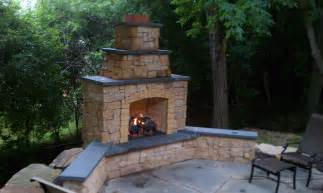 kasota outdoor fireplace with bluestone caps and gas log