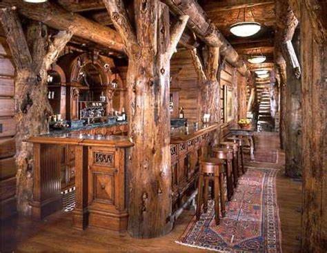 log cabin design built in bar is anchored on either end by massive log