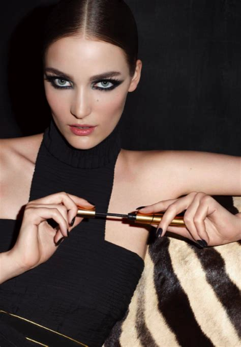 Log In To Win A Yves Laurent Black Patent Tribute Bag by Yves Laurent Eyeliner Effet Faux Cils Sea Black