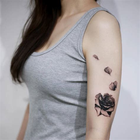 blooming rose tattoo blooming on the left arm