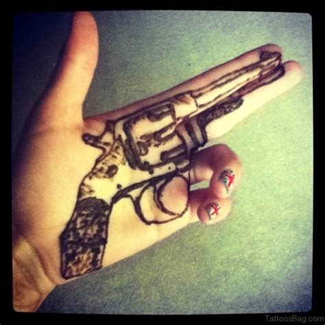 gun tattoo on hand 28 funky gun tattoos on